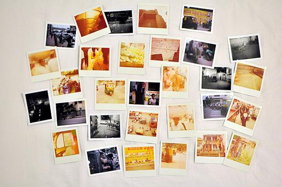 Polaroids On My Bed by Jon Madison